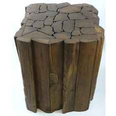 Pieces of recycled teak wood are pieced together to make this cool accent table. #worldstock #fairtrade
