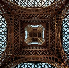Eiffel Tower....interesting angle - Looking up the skirt.....  of an icon by Kevin  Pepper, via 500px -