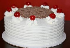 Recipe for making a whipped cream frosting that is soft, light, and not too sweet that goes on top of cakes.