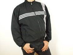 8883910ce Adidas windbreaker, Adidas jacket, Vintage adidas, black and gray three  white stripes 100% Polyester Size L 44/46 Made in LAO PDR