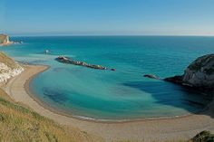 East Side Of Durdle Door, Durdle Dor, Looking Out Over St Oswald's Bay, Dorset, England, Uk (Jurassic Coast)