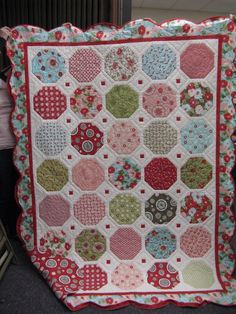 Scrappy snowball quilt! I love the accent of the tiny red squares in the sashing. AND, I love the way the quilting looks in the white space.