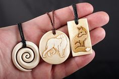 Triple Spiral, Bolshoi Borzoi and a Fox. Beefbone, stained. #bonecarving #pendant #fox
