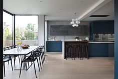 Our gorgeous Evans kitchen features a sophisticated bespoke design in a beautiful combination of deep blue matt lacquer cabinetry and a Patinated Silver finish. Kitchen Island With Cooker, Kitchen Gallery, Round House, Bespoke Design, Kitchens, Table, Evans, Furniture, Kitchen Ideas
