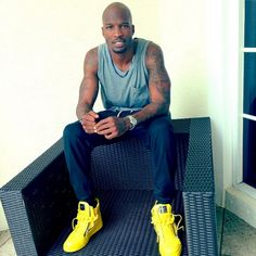 Kicks Of The Day: Chad Johnson's $1,050 Neon Giuseppe Zanotti Chain & Zipper Leather High-Top Sneakers- http://getmybuzzup.com/wp-content/uploads/2014/01/242983-thumb.png- http://getmybuzzup.com/chad-johnsons-1050-neon-giuseppe-zanotti/- Chad Johnson's $1,050 Neon Giuseppe Zanotti By Don Bleek  Former NFL player Chad Johnson was photo'd in a pair of $1,050 neon Giuseppe Zanotti Chain & Zipper Leather High-Top Sneakers. He paired his sneakers with a grey tank and