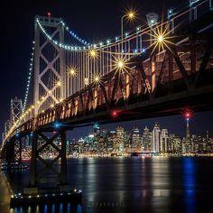 SF Bay Bridge captured in an Inspiring image by @heyengel [ the beacon ] : sf bay bridge and the transamerica beacon lit in the distance. treasure island adventures with some cool people, thanks to @whoisjanelle for the party invite. behind the scenes posted on snapchat. canon 6D 50mm f18 60 secs @thinktankphoto #sanfrancisco #baybridge #wildbayarea #rawcalifornia #streetsofsf #westcoast exposures #artofvisuals #createexplore #ig shotz bridges #ptk night #nightphotography #udog peopleandplaces #igpodium #awesome photographers #thecreative #cool capture #justgoshoot #zamanidurdur #igersmood #ig americas #ig global life #igpowerclub #nationaldestinations #moodygrams #inspiring photography admired #photographer #photography #instagood #instalove #inspiration Night Time Photography, Canon 6d, Beacon Lighting, Treasure Island, Bay Area, Just Go, West Coast, Behind The Scenes, Bridge