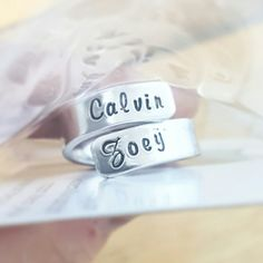 Had to snap a photo of this cute ring as I was packing it! So cute! Double wrap name ring by DreamWillowStudio on Etsy