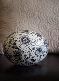 Black on white floral decorated egg