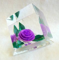Paperweight - My mom had a Lucite paperweight just like this only it had a red rose in it - almost 60 years ago.