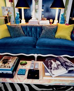 The vintage 1950s French sofa, reupholstered in candy-blue velvet, anchors the social area | domino.com