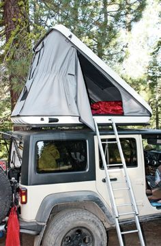 Jeep Wrangler With Discovery Evolutions Rooftop Tent - A must have when the trailin' begins.