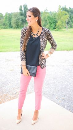 Colored skinnies, black LOOSE top, animal print cardigan and heels- this loose blouselike top seems key with this sweater.
