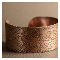 Etched copper cuff.