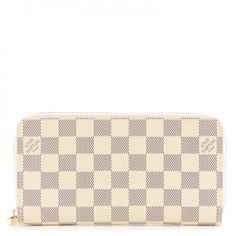 This is an authentic LOUIS VUITTON Damier Azur Zippy Wallet. This  sophisticated wallet is a 224341a3f7e9b