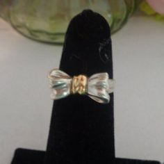 Vintage Retired Tiffany Sterling Silver and 18 kt Gold Bow Ring. The Ring is a Size 4.5 and comes in Tiffany Blue Pouch  www.CCCsVintageJewelry.com Free Shipping to the United States. Price is now $205.00