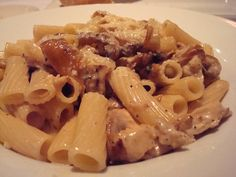Carmela's Chicken Rigatoni(Macaroni Grill) Caramelize 3 medium onions.Add 8 oz of cooked mushrooms,shredded chicken (I use one rotisserie chicken),3 oz of butter,3 oz of extra virgin olive oil,and 6 oz of Marsala wine. Simmer for 3-4 minutes.Add 20 oz heavy cream.Simmer another 3-4 minutes.Pour over cooked rigatoni noodles(16 oz box). Will thicken upon standing!!! Makes a ton of pasta!!! Super good! Enjoy!