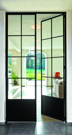 Strong forging Wrought iron doors and windows are often used in . Steel Frame Doors, Steel Doors And Windows, Metal Windows, Metal Doors, Iron Windows, Crittal Doors, Pine Interior Doors, Interior French Doors, Faux Stone Panels