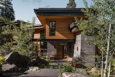 This waterfront home by US studio McCall Design and Planning is built into rugged granite boulders that face Idaho's Payette Lake Minecraft Cliff House, Clad Home, Canada House, Brown Brick, House On A Hill, House 2, Mountain Homes, Waterfront Homes, Cool House Designs