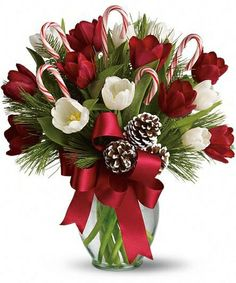 BY GOLLY IT'S JOLLY  Nothing's sweeter than Christmas tulips - except maybe Christmas tulips with candy canes! This jolly arrangement is about as fun and festive as they come, mixing fresh red and white tulips with fragrant Douglas fir and white pine. Say Merry Christmas to a teacher, friend or loved one far away.
