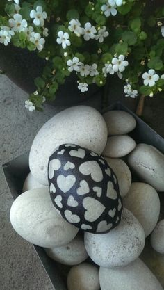 this could work-stickers like stars, hearts on the natural rock, then paint, remove stickers