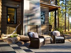 A double-sided fireplace lends warmth and ambience in both the master bedroom and patio, where a chimney, wrapped in matte hot-rolled steel and surrounded by site-sourced boulders, becomes a captivating focal point.  http://www.hgtv.com/dream-home/outdoor-kitchen-pictures-from-hgtv-dream-home-2014/pictures/page-9.html?soc=pindhm