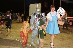Family Halloween Costumes...Yes I am that Mom... The Wizard of Oz Family (tin man is made from silver duct tape, card board, and lots of paint... my husband loved me that year LOL)
