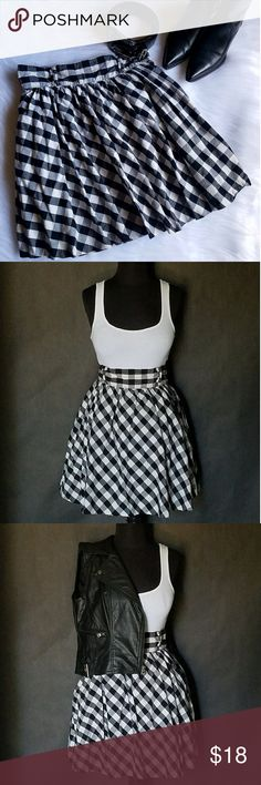 "High-Waisted Checkered Skirt If dresses aren't your thing, this bell-shaped skirt from Divided by H&M is for you. Features a checkered print and a cotton fabric with satin underlay, two deep side pockets with a back button and zipper closure. Double belt loops. In great condition. Measures 20"" long, 15"" waist. Marked as a size 10, but fits like an 8 (M); runs small. Perfect for dressing up for a Western or Rock star night out. No trades or PayPal. H&M Skirts Circle & Skater"