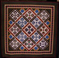 """Winter Garden by Maggie Ball, machine quilted by Wanda Rains, 86"""" x 86"""". Featured in Maggie Ball's book, Traditional Quilts with a Twist."""