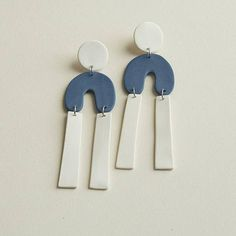 Colored porcelain earrings  •thin and lightweight •sterling silver post •unglazed •each piece is hand cut and may vary a bit   Care  Porcelain jewelry is fragile, but if cared for, can have a nice long life. Store them separately from other jewelry that may scratch or mark the