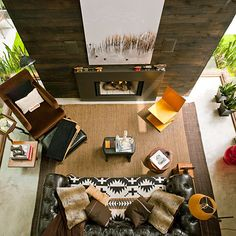 Design Tricks - Making small room look larger - think in 3 dimensions; ebony stained cedar fireplace wall rises twenty feet to the ceiling