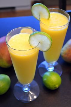 Mango Daiquiris: 2 fresh mangos, chopped into pieces, 2 trays worth of ice, 1/4 cup lime juice, 4 oz rum (Parrot Bay Mango Rum for even more mango flavor) and 1 tbsp sugar