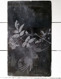 Engraved Slate 3.  These beautiful, reclaimed welsh roof slates have been wonderfully repurposed for interior wall adornment. Shingled in formation, the slate tiles are 'laser engraved' with an 'Espalier' design featuring a bird in flight alongside elderberry and apple blossom branches.   http://www.themintlist.com/product/engraved-slate-3