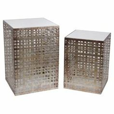 """Add a pop of chic style to your living room or master suite with these eye-catching end tables, showcasing openwork details and mirrored tops.   Product: Small and large end tableConstruction Material: Iron and mirrored glassColor: Grey and silverDimensions: Small: 18"""" H x 13"""" W x 13"""" DLarge: 18"""" H x 13"""" W x 13"""" D"""