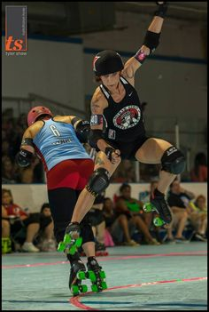 Wild Cherri K, of Atlanta Rollergirls, decides to go for Bonni Thunders, of Gotham. Bonni is hit out, but not before being hit into the air and floats to the floor! Talk about control. ECDX 2013 was amazing! Photo cred: Tyler Shaw