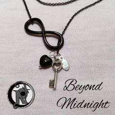 """*LIMITED EDITION*Chain: 18.0"""" Black Plated Link ChainInfinity: Black Plated Tibetan SilverHeart Key: Tibetan SilverHeart Pendant: Black GlassTag: NTIO (sterling silver)Size: Fits AllClose-up Photo: Not Actual SizeBeyond Midnight:The link chain is black plate. Remove before swimming, showering or sleeping for longer wear.  The sterling silver tag is hand stamped with the NTIO Logo on one side and bracelets that support an Artist, ..."""