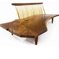George  Nakashima have been one of the premiere woodworking master who brought the natural element design into the home. He uses traditional Windsor chair making designs and incorporate them into his work.