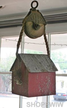 red barnwood birdhouse on pulley