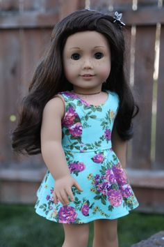 Turquoise and purple floral sleeveless dress by Closet4Chloe on Etsy. Made using the Versatility Dress pattern. Find it here http://www.pixiefaire.com/products/the-versatility-dress-18-doll-clothes. #pixiefaire #versatilitydress