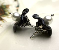 These are sooo beauiful. Black Ruffle Flower and Czech Pearl Dangle Charm Drop Set - 2 Pieces. $7.50, via Etsy.