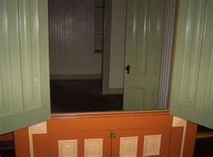 """Another way to watch people.....this """"cabinet"""" allowed her to see to the back of the house"""