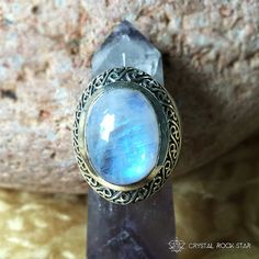 This gorgeous rainbow moonstone chatoyant ring will make you feel like a queen! The A quality oval moonstone cabochon is set in a gorgeous celtic inspired frame of 925 sterling silver. Available at www.crystalrockstar.etsy.com #rainbowmoonstone #jewelry #crystalhealing #ring #celtic #reiki #sacredgeometry #chakrahealing