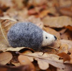 This cute little hedgehog will be your a great friend This little of handmade hedgehog figurine is made entirely out of wool using the art of needle felting. Hedgehog has black eyes, little nose and gorgeous grey fur coat.  Price is for one toy 100% wool, dimensions  length- 6 cm (2.3 inches) height --3 cm(1 inches) This toy is for children from 2years This toy is an ideal gift for your baby or friend It is soft and gentle, and easily fits into the palm. It is nice to play. This creature…