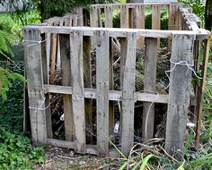 Make a compost bin easily out of pallets. Just check that the pallets aren't treated with any kind of wood preservative or chemicals or that will leach into the compost.