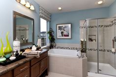 The master bathroom in The Avonleigh model in Austin Texas. Love the pebble stone accents in the tile in the bath and shower.