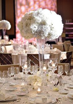 White #Wedding Centerpiece Ideas from Bob & Dawn Davis Photography. To see more: http://www.modwedding.com/2013/09/29/photographer-of-the-day-bob-dawn-davis-photography #weddingcenterpiece