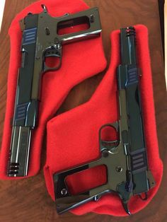 Pair of compensated, blued Cabot Guns 1911s. What a colour!