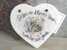 This unique sister gift ornament says, Sisters are different flowers from the same garden. Its a handmade salt dough heart ornament, its