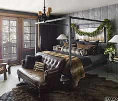 A steel bed by Room & Board is paired with a 1920s leather sofa in the Elvis suite; the bed linens and side tables are by Ralph Lauren Home, the ceiling light is by Maarten Baas, and the wallpaper is by Phillip Jeffries.
