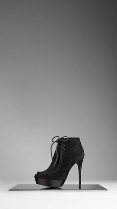 Shearling lined platform ankle boots by Burberry