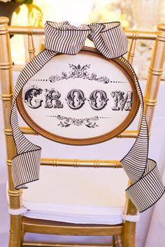Fancy wedding chair with free Wedding Chicks printable Groom Sign.  http://www.weddingchicks.com/freebies/wedding-signs-labels/custom-bride-and-groom-signs/